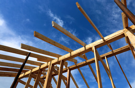rafters: Installation of wooden beams at construction the roof truss system of the frame house
