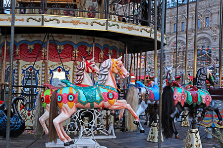 festively: MOSCOW, RUSSIA - JANUARY 16, 2015: Festively decorated roundabout Carousel on the Red Square in Moscow