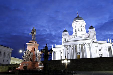 st nicholas cathedral: Monument to Russian Emperor Alexander II on the Senate Square and Cathedral of St. Nicholas (Cathedral Basilica) in Helsinki at night