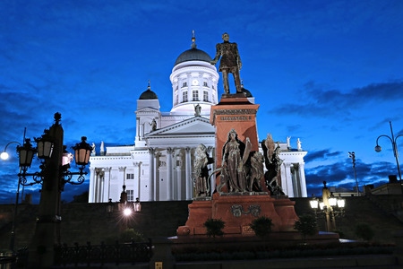 senate: Monument to Russian Emperor Alexander II on the Senate Square and Cathedral of St. Nicholas (Cathedral Basilica) in Helsinki at night
