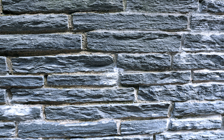 seams: Background of gray flagstone rocks with cement seams