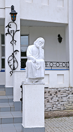 the righteous: Statue of monk with key sitting in Raif monastery Stock Photo
