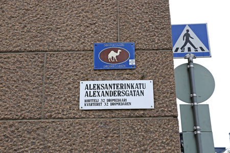 burro: HELSINKI, FINLAND - JULY 8, 2015: The sign with the image of a camel indicating quarter in the center of Helsinki Editorial