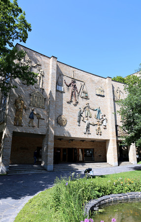 stucco facade: HELSINKI, FINLAND – JULY 9, 2015: Facade Aalto University School of Business in Helsinki with the artistic stucco figures of people of different nationalities