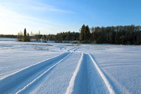 rut: Landscape winter road in a snowy field Stock Photo