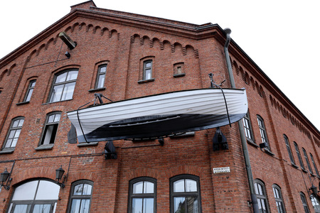 suomi: HELSINKI, FINLAND - JULY 6, 2015: Boat on the facade of the building in Helsinki