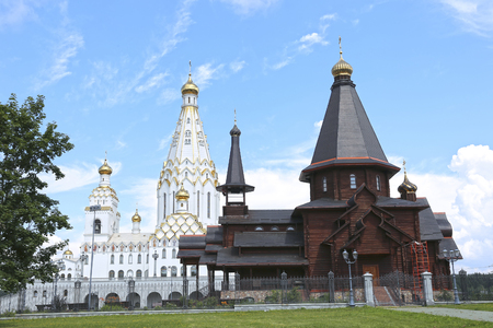 holiness: MINSK, BELARUS - JULY 20, 2014: Memorial Church of All Saints in Minsk and wooden Trinity Church