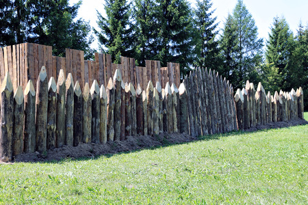 impregnable: A fence made of sharpened pointed logs