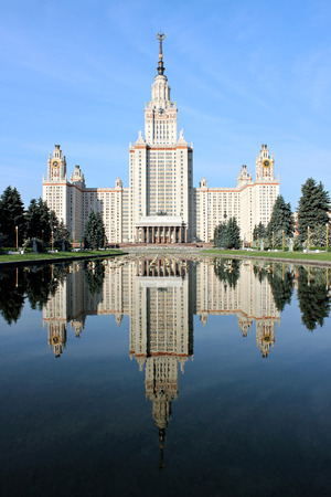 university fountain: MOSCOW, RUSSIA - JUNE 22, 2012: Moscow State University named after Lomonosov against the blue sky