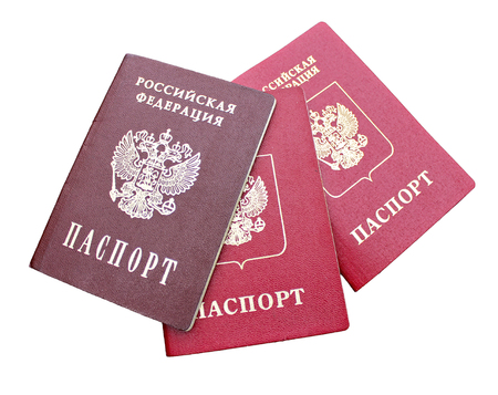 russian federation: Three passports of a citizen of  Russian Federation isolated on white background. The inscriptions in Russian Russian Federation. Passport