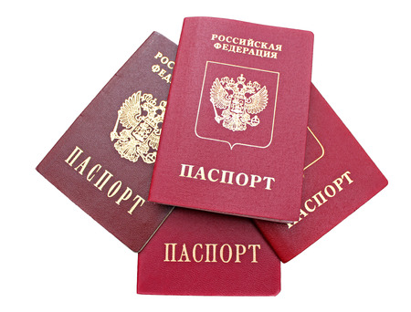 the federation: Several passports of a citizen of  Russian Federation isolated on white background. The inscriptions in Russian Russian Federation. Passport Stock Photo