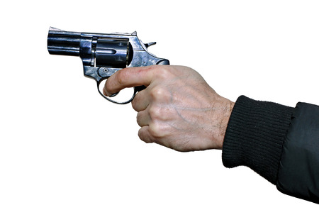 finger on trigger: Black revolver in a male hand isolated on white background