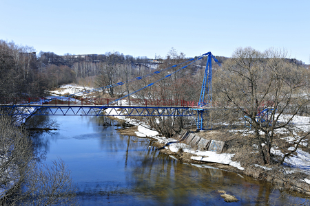 shrouds: Cable-stayed steel bridge over a river Istra in Russia on a sunny day Stock Photo