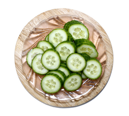 gherkins: Fresh sliced cucumber on board isolated on white background