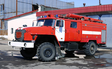accident fire truck: Red fire truck with water cannons in Russia Stock Photo