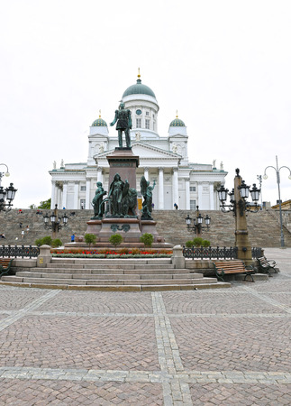 st nicholas cathedral: HELSINKI, FINLAND - JULY 6, 2015: Cathedral of St. Nicholas (Cathedral Basilica) and monument to Alexander II on the Senate Square Editorial