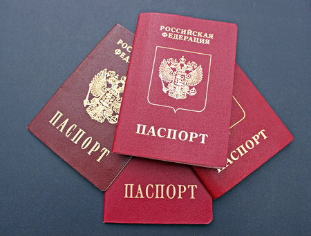 jurisdiction: Several passports of a citizen of  Russian Federation on black background. The inscriptions in Russian Russian Federation. Passport