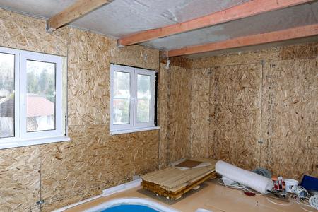 sheathing: Construction of frame house wall sheathing of OSB