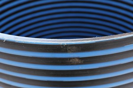sump: Plastic striped pipe repair manhole ring close-up