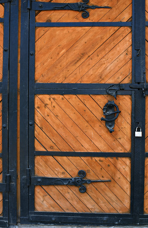 wicket gate: Old large wooden carved gate in Russia