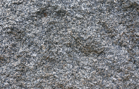 scabrous: Texture of gray unprocessed rough granite closeup Stock Photo