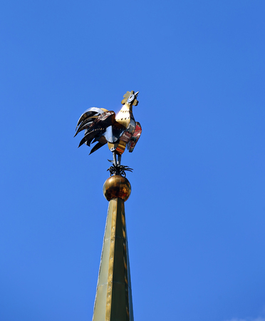 outbuilding: Weathervane in the form of a golden rooster on the spire of tall tower