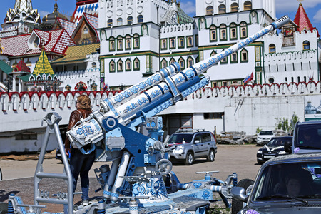 wheel barrel: MOSCOW, RUSSIA - MAY 7, 2016: Cannon, painted in the style of traditional Russian Khokhloma in the Izmailovo Kremlin in Moscow