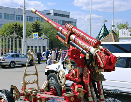 wheel barrel: MOSCOW, RUSSIA - MAY 7, 2016: Cannon, painted in the style of a traditional Palekh painting in the Izmailovo Kremlin in Moscow