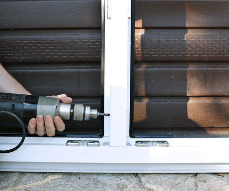 mounting holes: Adjusting and installation of white plastic window in home