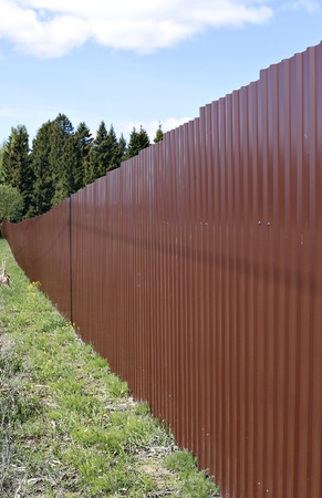 A fence made of brown metal professional flooring Stock Photo