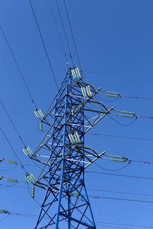 Mast electrical power line on a sunny day