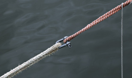 spanned: Marine ropes and fasteners on a background of water
