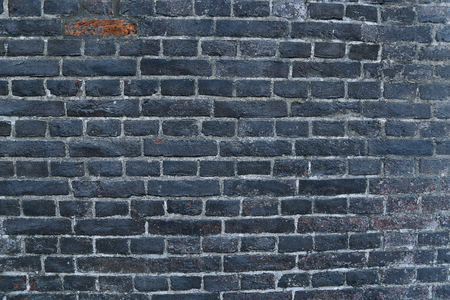 hardened: Texture of a black burnt sooty brick wall