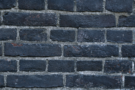 sooty: Texture of a black burnt sooty brick wall