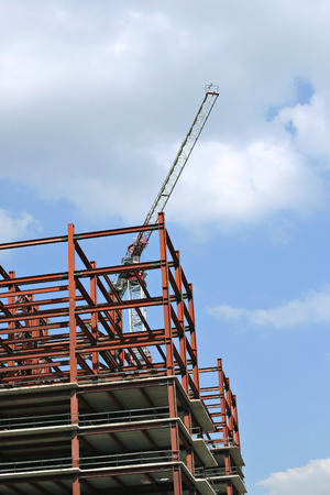Construction of multistory building of metalwork with a construction crane