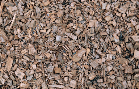 Background of painted wood chips on the soil in the garden Stock Photo