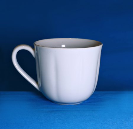 White cup on a blue background