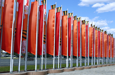 Beautiful red festive flags against the sky