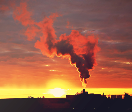 Smoke rising into the sky from an industrial chimney