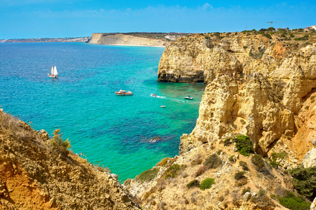 Cliff rocks and sea bay with turquoise water in Lagos, Algarve region, Portugal Stock Photo