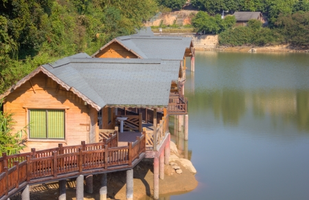 This is a picture of lakeside cabins was taken in XiaMen TianZhu Mountains,China  photo