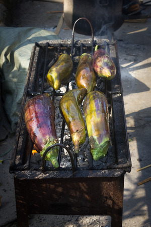 travel features: This is a photo of chinese Dai peoples roasted eggplant, was taken in Yunnan, China. Stock Photo