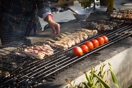 travel features: This is a photo of chinese Dai peoples barbecue, was taken in Yunnan, China. Stock Photo