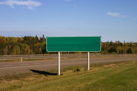 blank green highway sign in automn