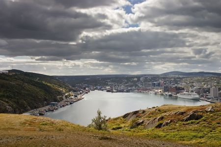 Saint Johns Newfoundland Harbour under a partially cloudy sky