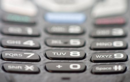 extreme close-up of cellular phone keypad with shallow depth of field photo