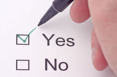 Someone indicating yes on a survey in green pen Stock fotó