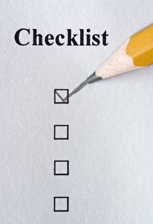 filled out: Checklist being filled out in pencil with texture showing in paper