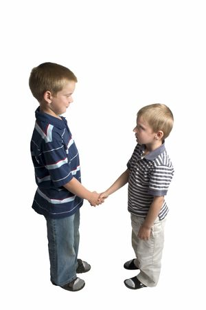 two young boys shaking hands isolated on white background