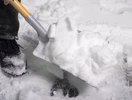 shovelling snow after a snow storm Stock Photo - 2738056
